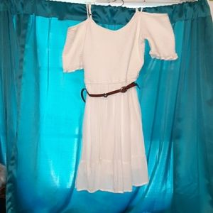 A white off the shoulder dress; belt incuded.